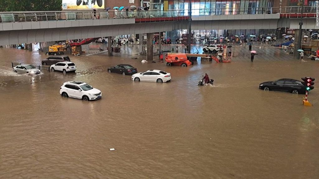 Passengers trapped inside submerged subway as deadly floods sweep central China!